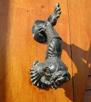 dolphin hand knocker